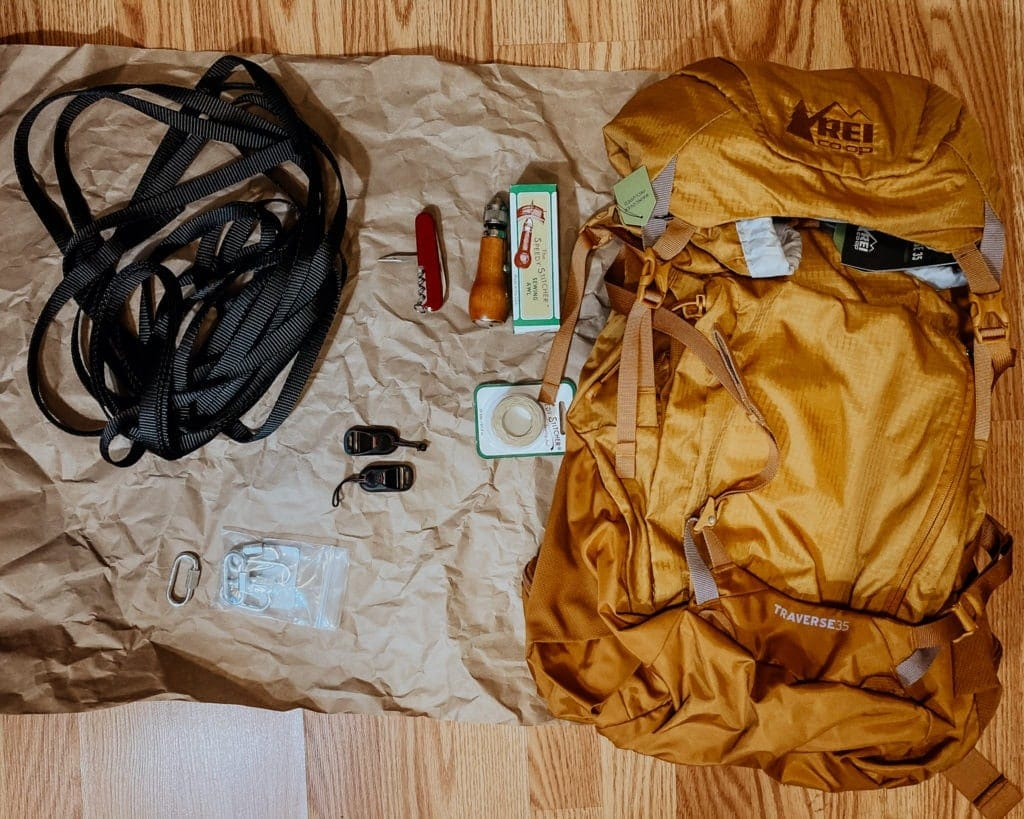 A casual flatlay image of the materials needed to create this hiking camera harness.
