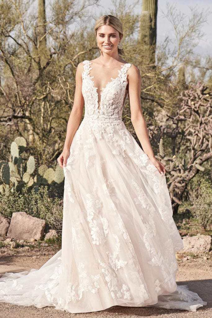 elopement dress with dramatic neckline and lace.